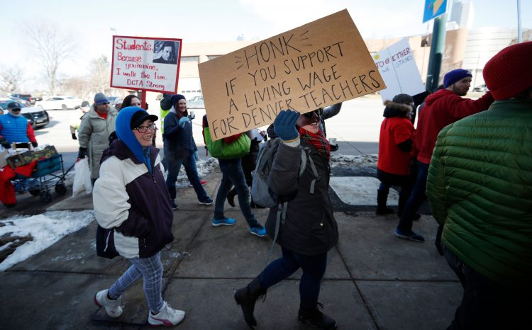 Educators  strike  for  greater  pay  because  administration  and  benefits  take  too  much  money