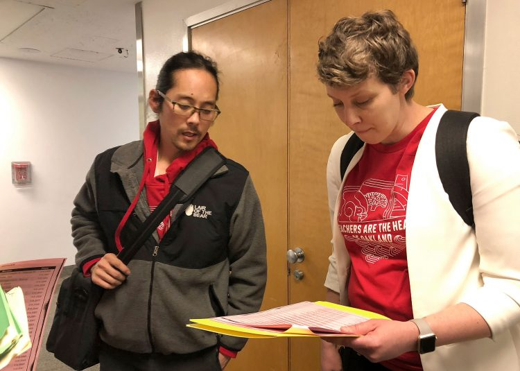 It's  official:  Oakland  instructors  walk  out  for  more  pay,  extra  support  personnel